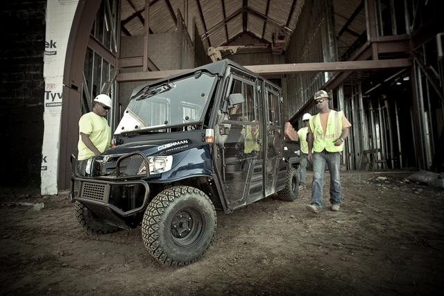 Cushman UTV construction workers