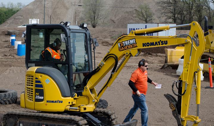 Student driving a Komatsu Excavator
