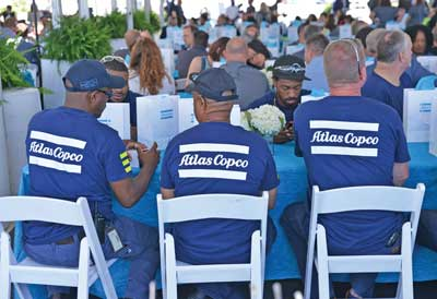 Atlas Copco grand opening: employees sitting at the tables