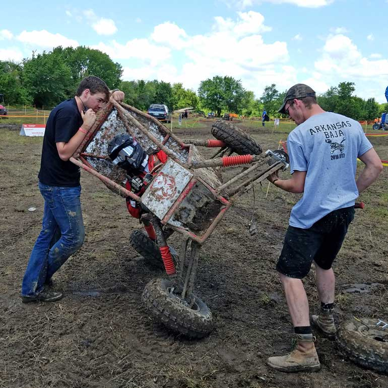 Engineering students build and test their all-terrain vehicle to survive the severe punishment of rough terrain in the Baja Collegiate Design Competition's dynamic events.