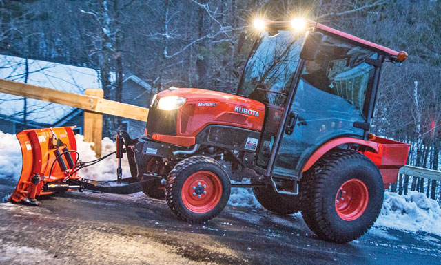 Kubota B2650 Series with a front hitch and blade