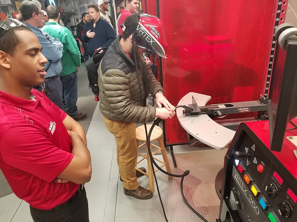 Compact Equipment contributing editor Brad Kramer tries his hand at the Lincoln Electric Vertex virtual reality weld simulator in the American Welding Society trailer.