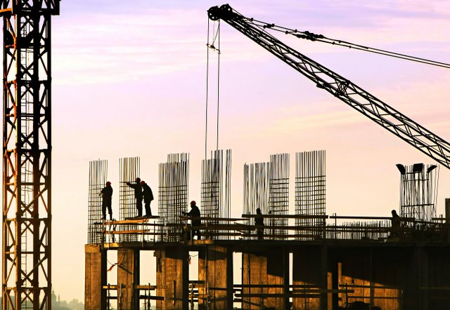 construction-workers-working-on-big-building-project-cut-2111111-1-1