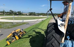 Spider slope mower races around the banks of Daytona International Speedway