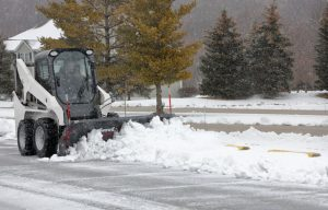 SnowEx Offers Oscillating Skid Steer Mount for Snowplows