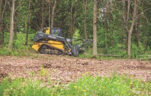 New John Deere Mulching Head Shreds Wood in Minutes
