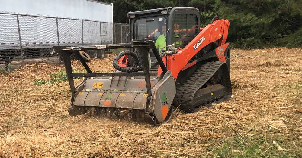 the mulcher and track loader combination is ideal for land management