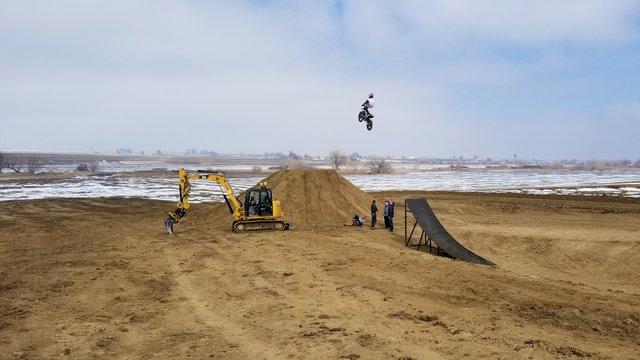 Cat excavator Trimble motorcross bike jump