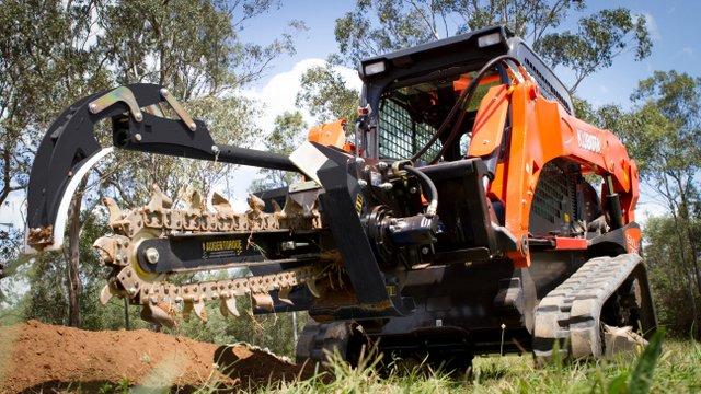 Auger torque trencher skid steer track loader