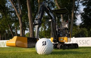 Enjoy Some Photos of John Deere Construction Machinery Redesigned as Giant Golf Putters/Flag Holder
