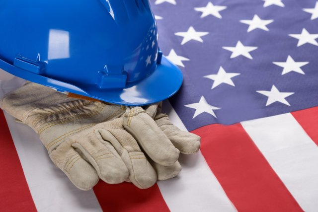 Hardhat And Gloves On American Flag