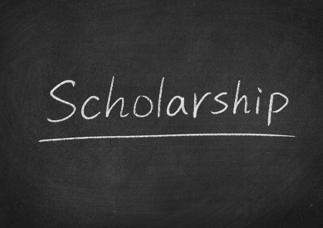 scholarship concept word on a blackboard background