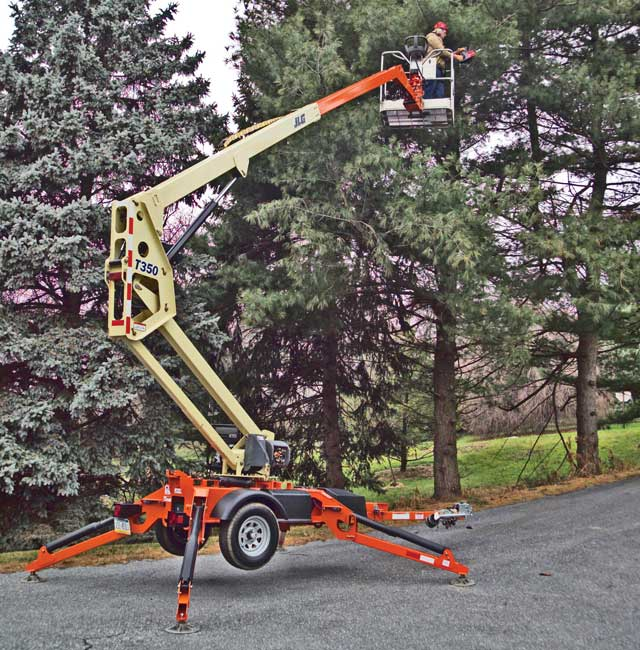 Towable boom lifts