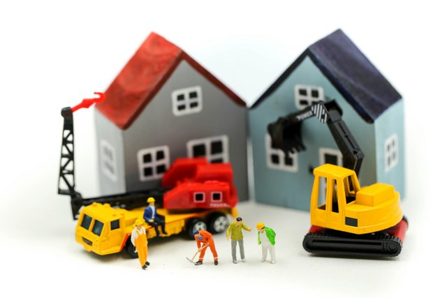 Miniature people : worker team for building home ,Image use for