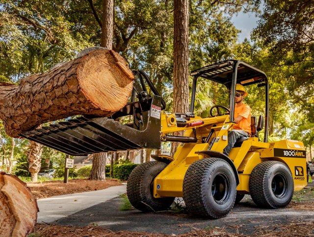 1800AWL Rayco loader holding log