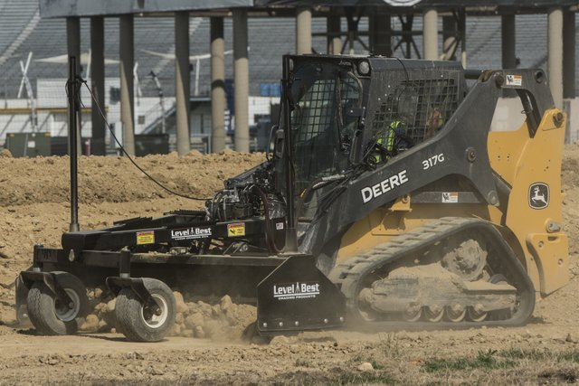John Deere track loader with grade control attachment