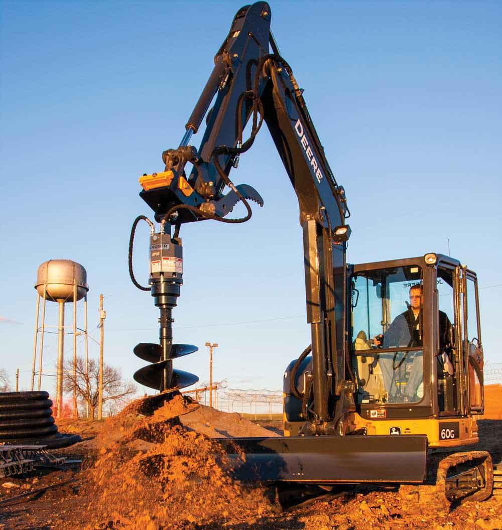 John Deere excavator with Danuser auger attachment