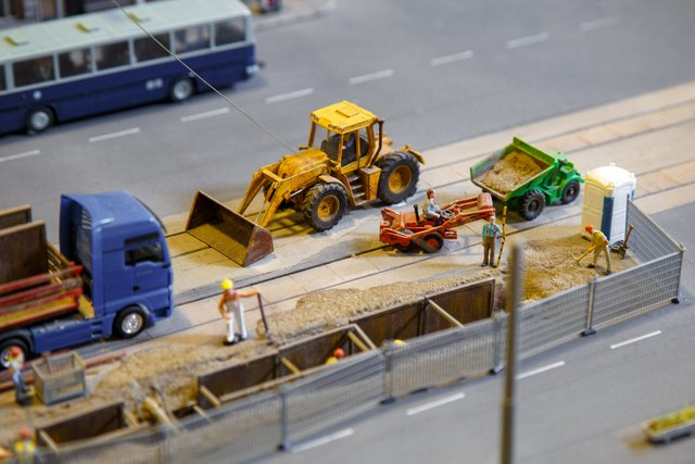 View of construction site of mini toy workers and vehicle
