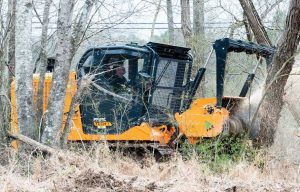 Land Clearing Tractors  vs. Forestry Track Loaders, Grinding through the Price, Power and Application Differences