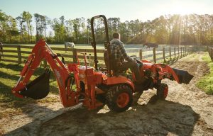 Equipped to Dig: Pair Your Compact Tractor with a Backhoe for Even More Productivity