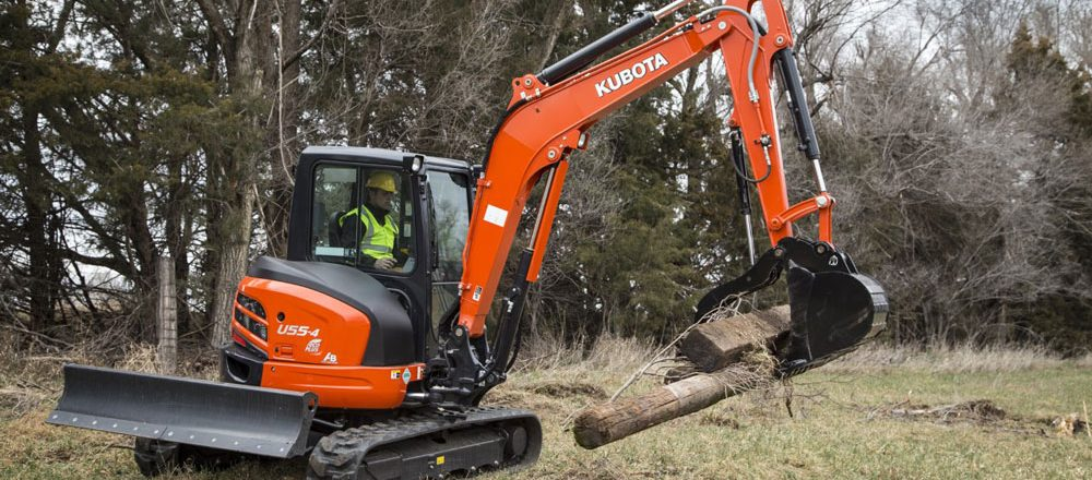 Kubota excavator with grapple attachment