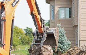 Learn How a Mini Excavator Can Tackle Boulder Retention Wall Construction