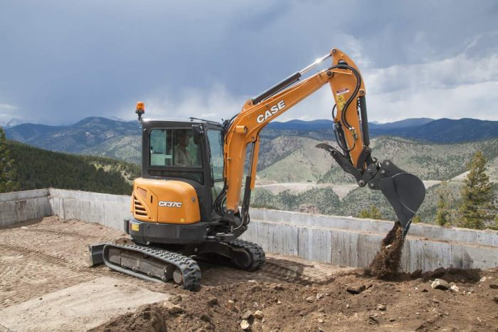Case mini excavator digging dirt