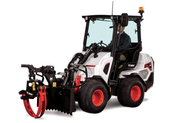 Bobcat 128 articulated wheel loader with log grapple attachment
