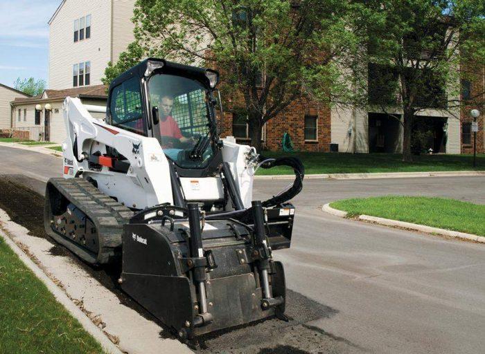 Bobcat track loader operating a cold planer