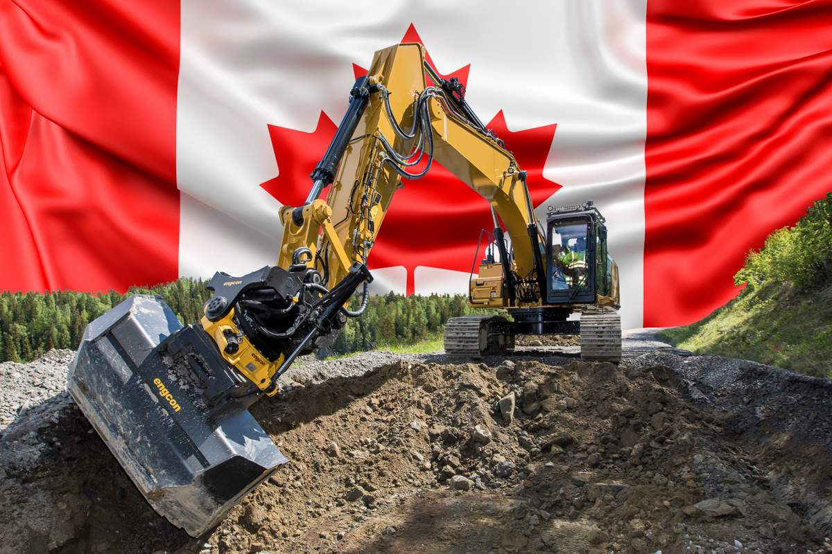 excavator digging with canadian flag in the background