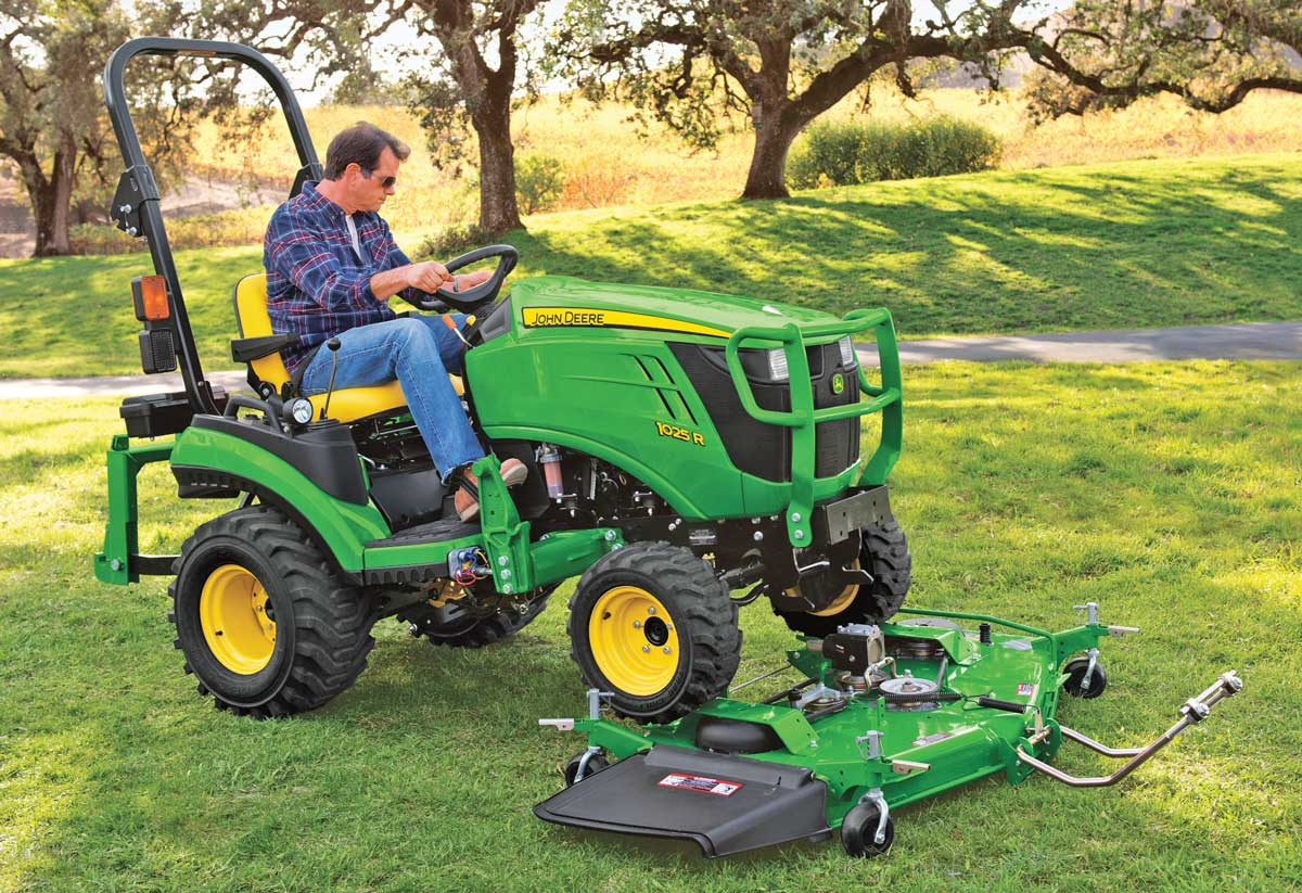 John Deere 1025R tractor with mower attachment