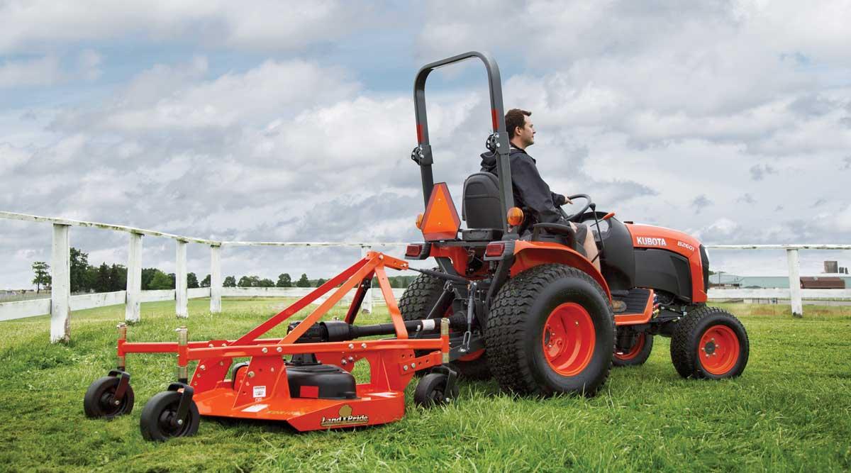 Kubota B2601 tractor with mower attachment