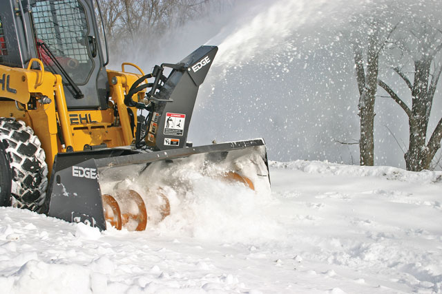 Watch How Over-the-Tire Tracks Can Turn Your Skid Steer into a Solid Snow Machine