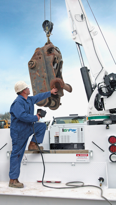 Truck-integrated systems such as an EnPak allow field mechanics to run hydraulic cranes with the main truck engine turned off.