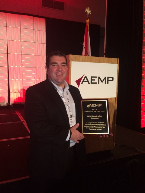 Pat Hunt, CASE Construction Equipment's Director of Strategic Accounts, accepts the Associate of the Year award at the annual AEMP conference in Orlando