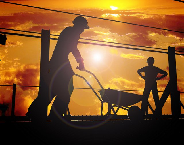 construction workers wheelbarrow sunset