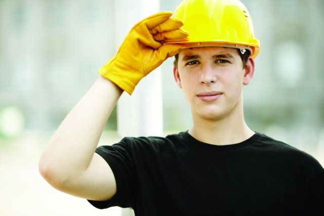 construction worker holding hardhat (Cut 2)
