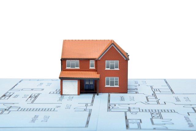Model house on blueprints