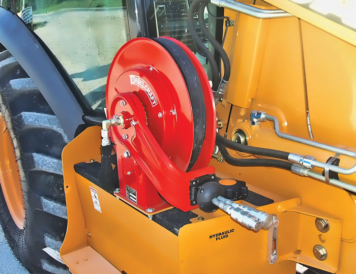 This 25-ft dual line hydraulics hose reel with quick-disconnect couplers allows the operator to extend the reach for hand tools when running off the auxiliary hydraulics of a skid steer or backhoe loader.