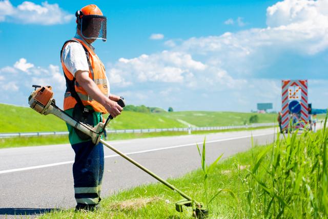 landscaper weed eater road work
