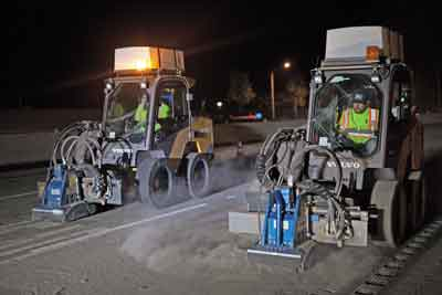 Performance is what led Jeff Llewellyn and his industrialist team to develop a proprietary modification to their skid steer loader to more efficiently remove cat's eye reflectors on roads at high speed.